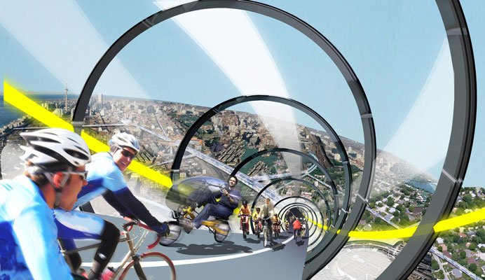 Cyclists riding down an enclosed glass tube.